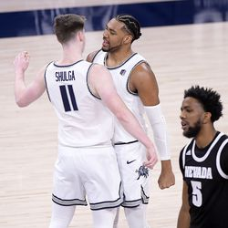 Utah State guard Max Shulga (11) and forward Alphonso Anderson celebrated during a timeout as Nevada forward Warren Washington (5) walks to the bench during the first half of an NCAA college basketball game Sunday, Feb. 28, 2021, in Logan, Utah.