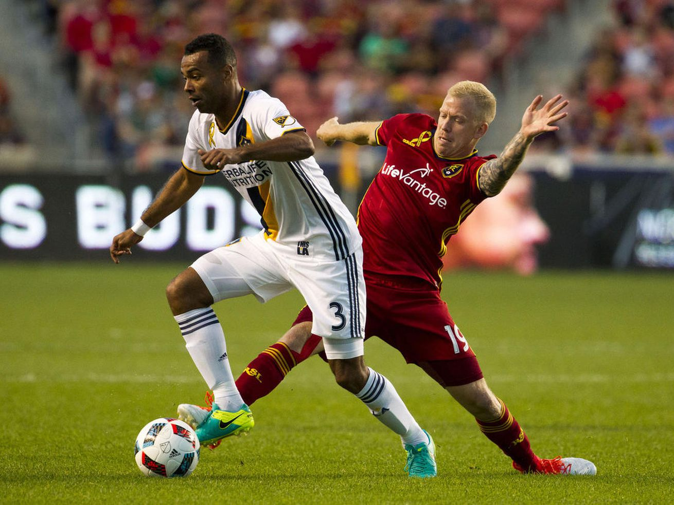 Real Salt Lake midfielder Luke Mulholland (19) defends against Los Angeles Galaxy defender Ashley Cole (3) during an MLS soccer match in Sandy on Wednesday, Sept. 7, 2016.