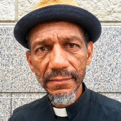FILE – In this Oct. 5, 2017 file photo, Darryl Gray, a pastor with deep roots in civil rights activism who serves as a mentor to the unofficial leaders of the so-called Frontline protest movement, poses for a photo in St. Louis. Six deaths, all involving men with connections to protests in Ferguson, Missouri, drew attention on social media and speculation in the activist community that something sinister was at play. Gray said he found a box inside his car. When the bomb squad arrived, no explosives were found but a 6-foot python was inside. Activists and observers remain puzzled, especially since people involved in the protests continue to face harassment and threats. (AP Photo/ Jim Salter, File)