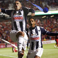 Humberto Suazo and Sergio Santana from the Rayados of Monterrey celebrate the first goal against Real Salt Lake during the final game of the CONCACAF championship at Rio Tinto Stadium in Sandy Wednesday, April 27, 2011.