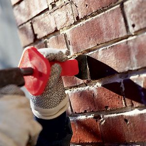 Chipping Out Old Mortar In Vertical Joints With Chisel