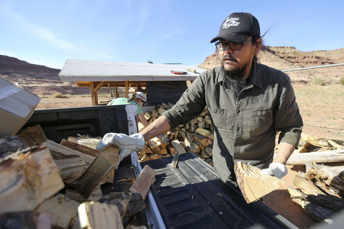 Pete Sands, Utah Navajo COVID-19 Relief program project manager, delivers wood to an elder in Oljato-Monument Valley, San Juan County, on Wednesday, April 29, 2020. TheNavajo Nation has one of the highest per capita COVID-19 infection rates in the country.