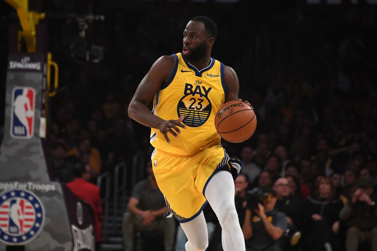 Golden State Warriors forward Draymond Green dribbles the ball against the Los Angeles Lakers in the second quarter at Staples Center.