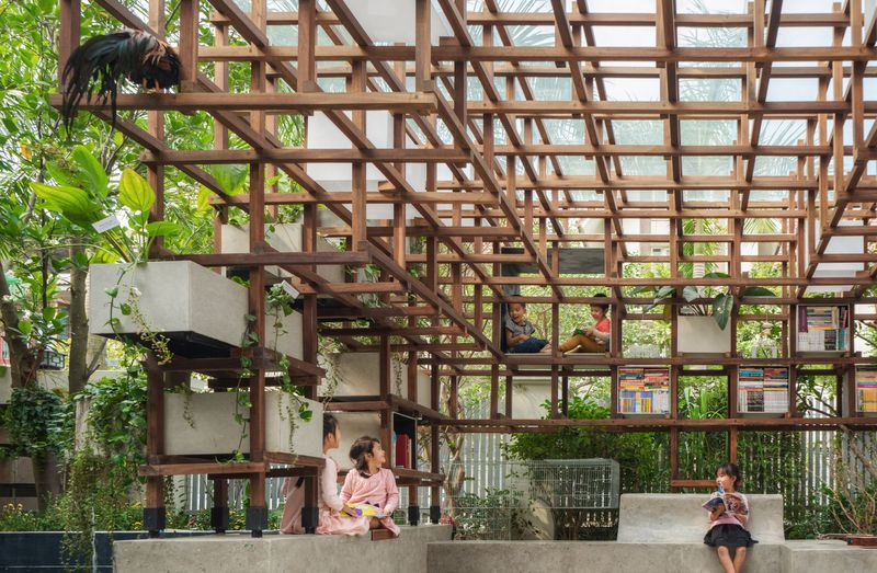 Kids sitting under wooden pavilion
