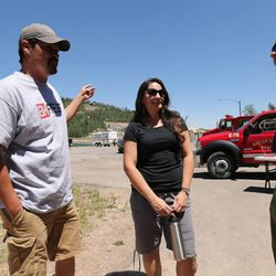 Bob and Kery Whitelaw talk with Brandon Hampton, National Incident manager, as the Brian Head Fire continues to burn on Friday, June 30, 2017. The Whitelaws have a condo rental business in Brian Head.