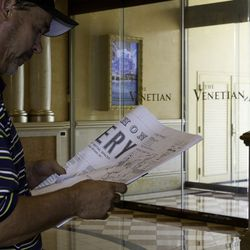 A contractor looks at the blueprints for Bouchon Bakery.