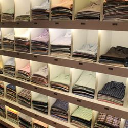 Great Wall of Polos – the middle row is women's, but everything else is men's.