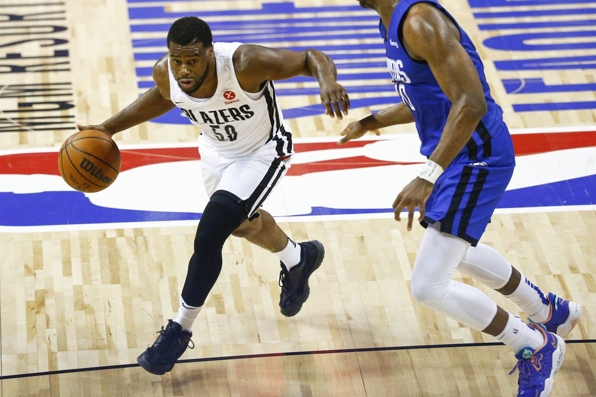 Portland Trail Blazers' Emmanuel Mudiay drives to the basket against Los Angeles Clippers' Daniel Oturu.