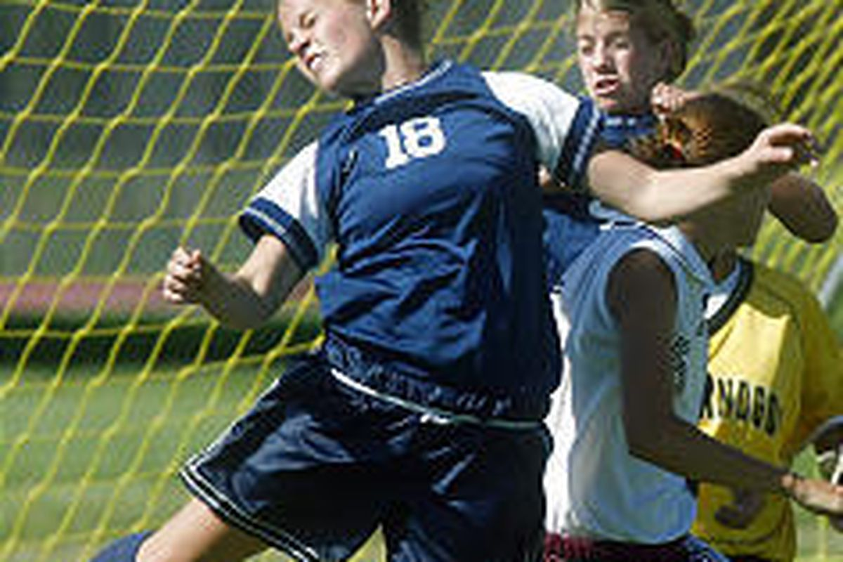 Timpanogos' Kelli Hegerhorst (18) tries heading the ball into the goal Thursday, but her shot did not go past the Mountain View goalie.