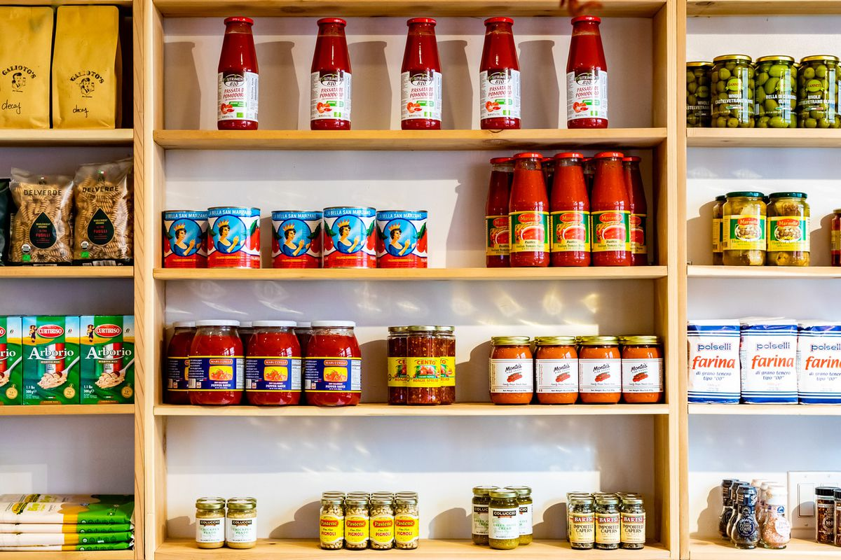 Inside a shelf at Galioto's, a series of sauces, spices, and pastes on different shelves
