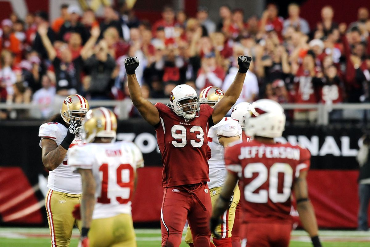 GLENDALE, AZ - DECEMBER 11:  Calais Campbell #93 of the Arizona Cardinals celebrates a victory against the San Francisco 49ers at University of Phoenix Stadium on December 11, 2011 in Glendale, Arizona.  (Photo by Norm Hall/Getty Images)