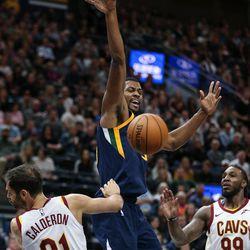 Utah Jazz forward Derrick Favors (15) loses the ball as he goes up against Cleveland Cavaliers guard Jose Calderon (81) at Vivint Arena in Salt Lake City on Saturday, Dec. 30, 2017.