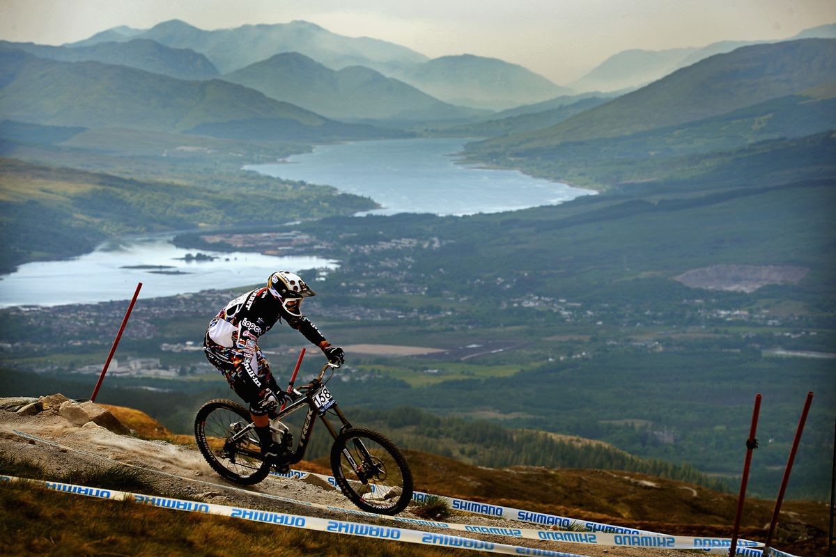 Fabbien Cousine of France competes in the men's downhill qualifying round at the UCI Mountain Bike World Cup on June 8, 2013 in Fort William,Scotland.