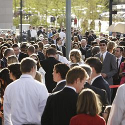 Attendees walk to the Conference Center prior to the 182nd Annual General Conference for The Church of Jesus Christ of Latter-day Saints in Salt Lake City  Saturday, March 31, 2012.
