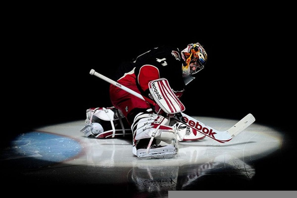 Mar 1., 2012; Glendale, AZ, USA; Phoenix Coyotes goalie Mike Smith (41) stretches prior to the game against the Calgary Flames at Jobing.com Arena. Mandatory Credit: Matt Kartozian-US PRESSWIRE