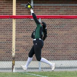 Clearfield left fielder Hailee Smith makes a leaping catch at the fence during a game against Bountiful at Millcreek Junior High School in Bountiful on Wednesday, March 24, 2021.