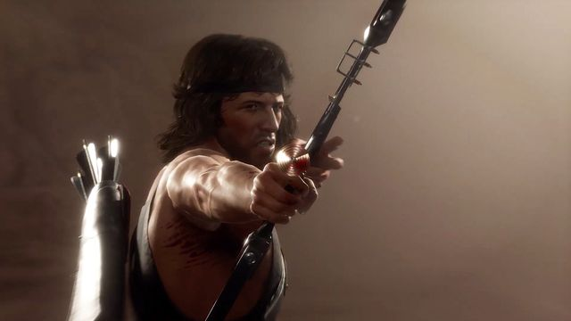 Rambo aims an explosive arrow in a still from Mortal Kombat 11