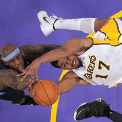Denver Nuggets power forward Al Harrington, left, and Los Angeles Lakers center Andrew Bynum battle for a rebound during the first half of an NBA first-round playoff basketball game, Sunday, April 29, 2012, in Los Angeles.