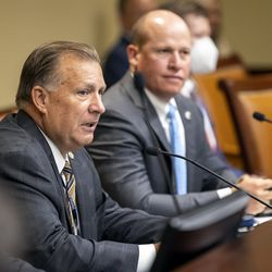 Sen. Curt Bramble, R-Provo, center, speaks to several hundred people who showed up at the Legislature's Business and Labor Interim Committee at the Capitol in Salt Lake City on Monday, Oct. 4, 2021, to express their opinions about the Biden administration's COVID-19 vaccine mandate.