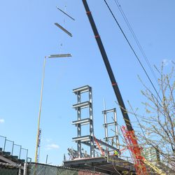 2:06 p.m. Three more beams being lifted up -