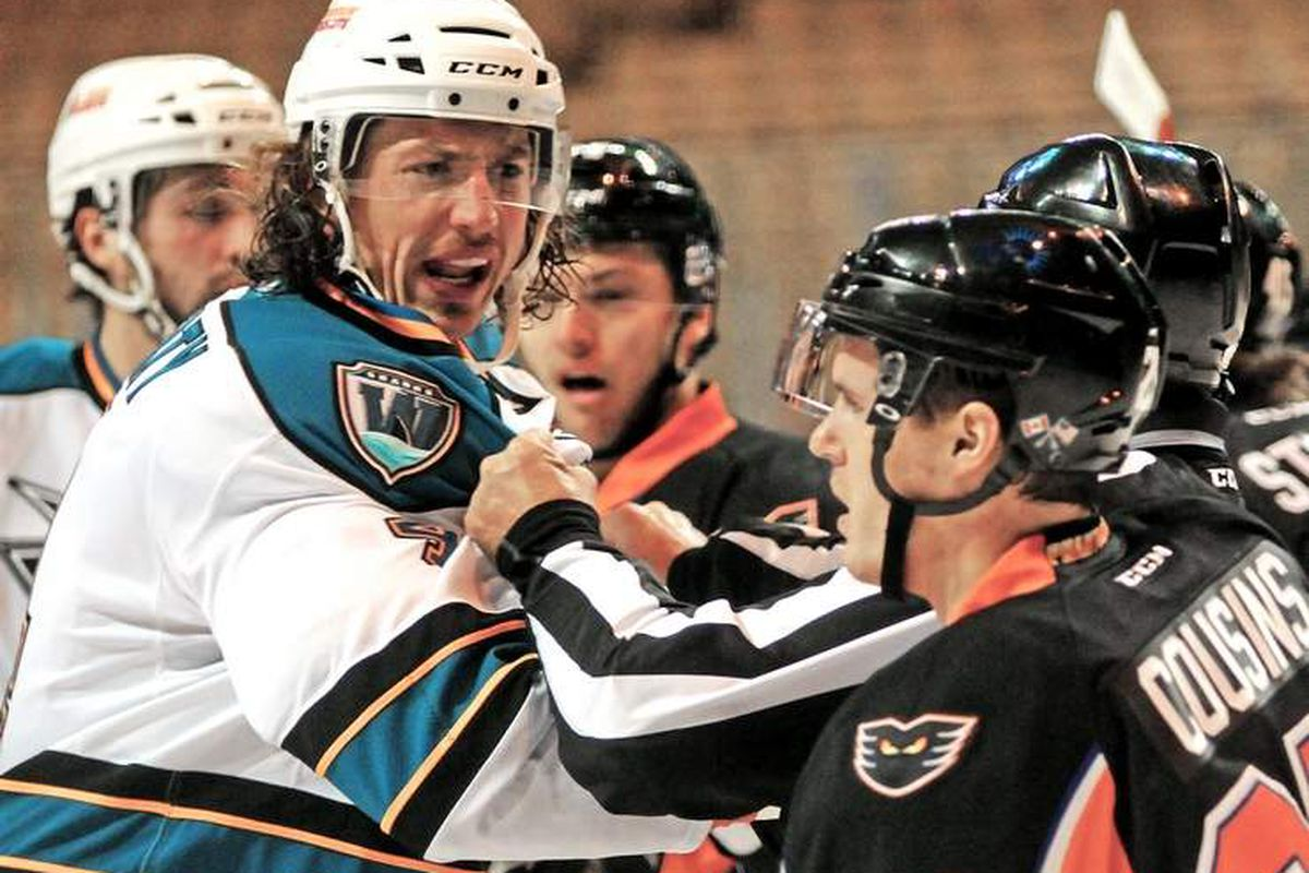 Worcester Sharks defenseman Taylor Doherty has words with Nick Cousins of the Lehigh Valley Phantoms during Wednesday night's game at the DCU Center (Steve Lanava/Telegram.com)