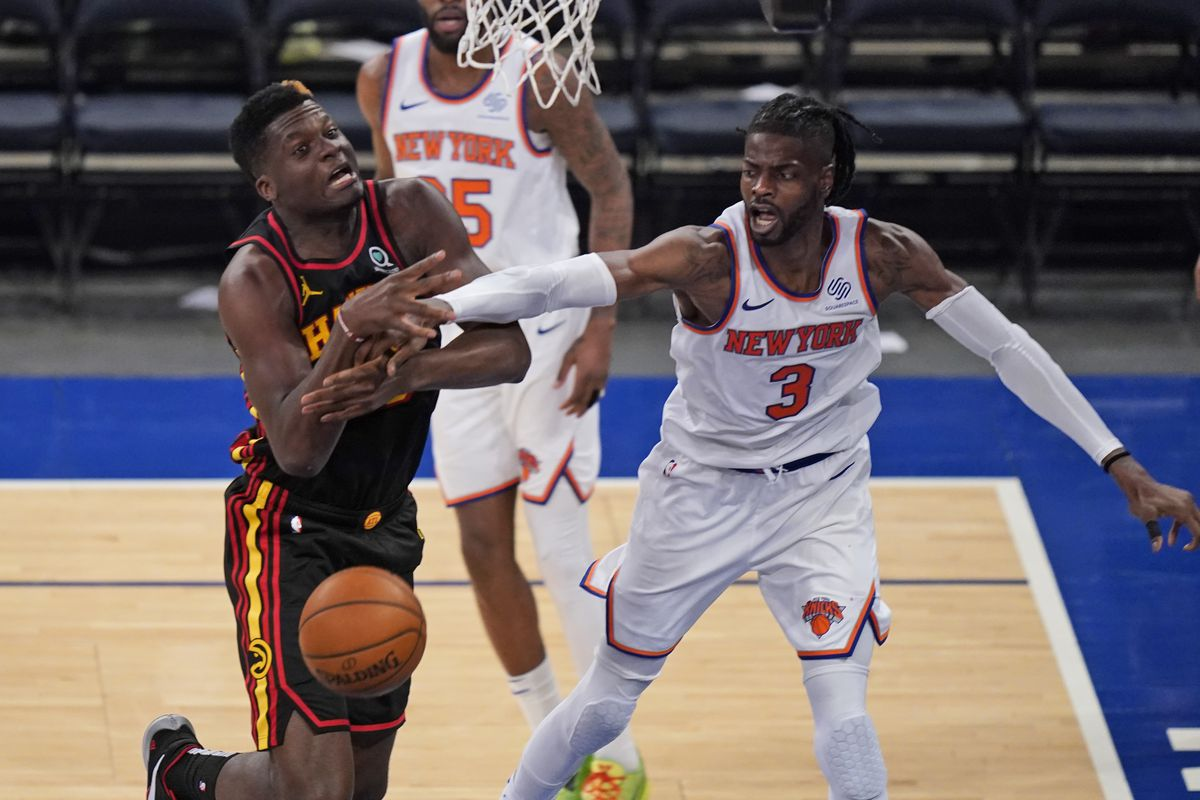 New York Knicks' Nerlens Noel, right, fouls Atlanta Hawks' Clint Capela during the second half of Game 1 of an NBA basketball first-round playoff series on May 23, 2021 in New York City.
