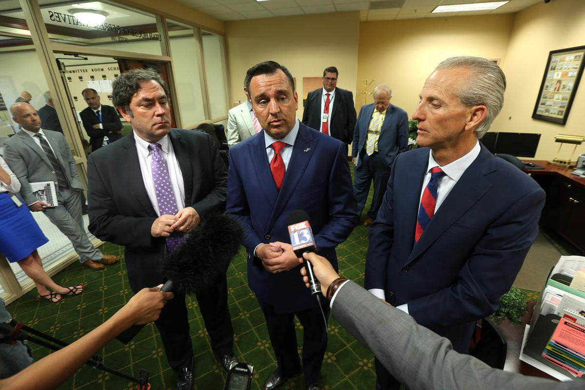 Speaker Greg Hughes, R-Draper, center, is joined by Minority Leader Rep. Brian King, D-Salt Lake City, left, and Senate President Wayne Niederhauser, R-Sandy, right, as they talk with members of the media at the Capitol in Salt Lake City on Tuesday, June