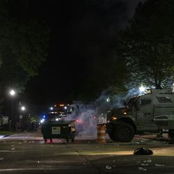Two police bearcats advance towards Civic Center Park attempting to disperse protesters during a protest over the shooting of Jacob Blake, Tuesday, Aug. 25, 2020, in Kenosha, Wis.