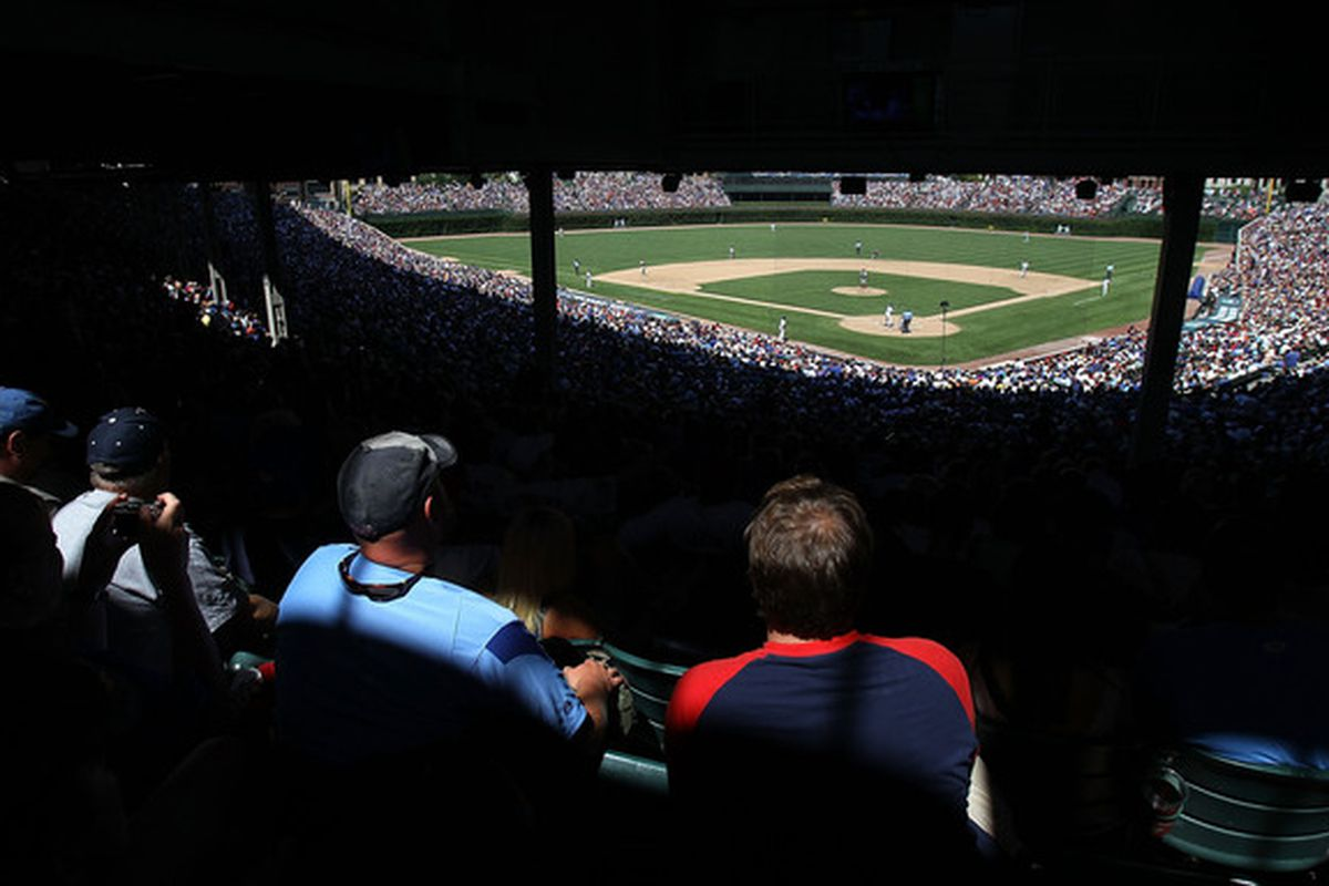 CHICAGO - JULY 16: Fans watch as the Chicago Cubs take on the Philadelphia Phillies at Wrigley Field on July 16 2010 in Chicago Illinois. The Cubs defeated the Phillies 4-3. (Photo by Jonathan Daniel/Getty Images)