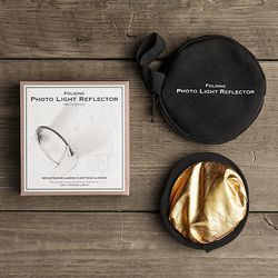 <b>For the Selfie-Loving Gay</b><br> Good lighting is crucial, but not always easy to come by. For those important selfies, the <b>Folding Light Reflector</b> is an Instagrammer's —or, a professional photographer's— best friend. Pick it up fo