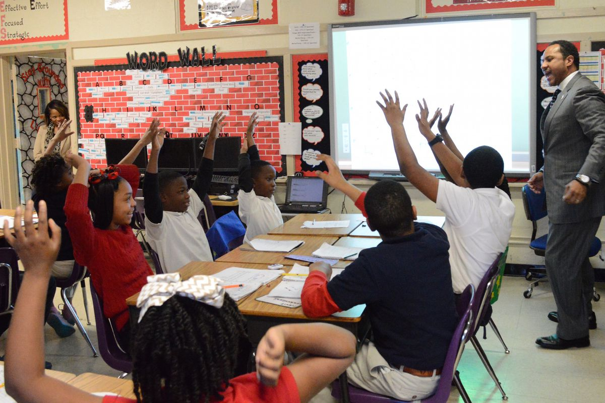 A Memphis teacher engages with his students at Cherokee Elementary School.