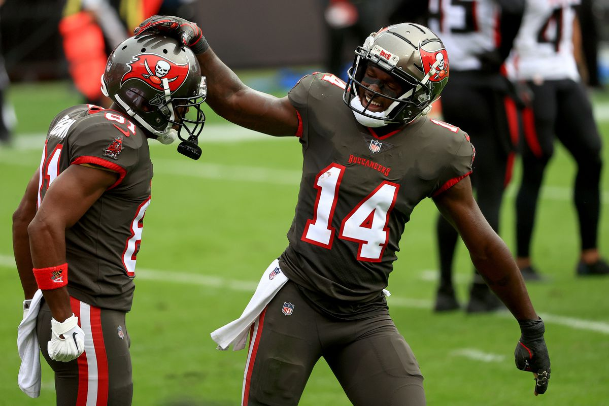 Antonio Brown #81 of the Tampa Bay Buccaneers celebrates a touchdown with Chris Godwin #14 during a game against the Atlanta Falcons at Raymond James Stadium on January 03, 2021 in Tampa, Florida.