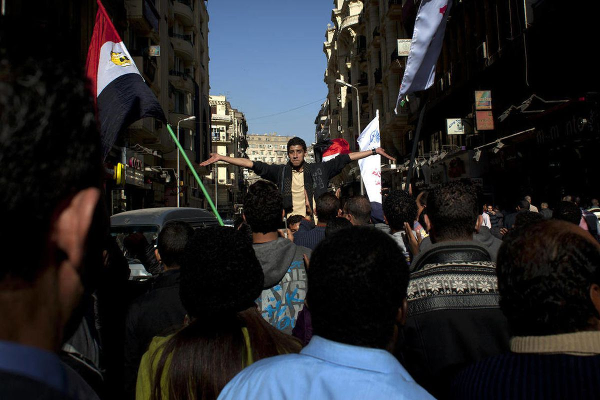 Egyptian protesters chant slogans.