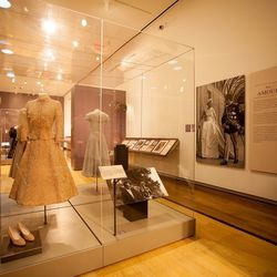 The exhibit traces Kelly's romance with Prince Rainier, and showcases the outfit that she wore for her civil marriage ceremony: a beige lace and dusty rose silk suit designed by Hollywood costume designer Helen Rose. [Image credit: Natalie Wi]