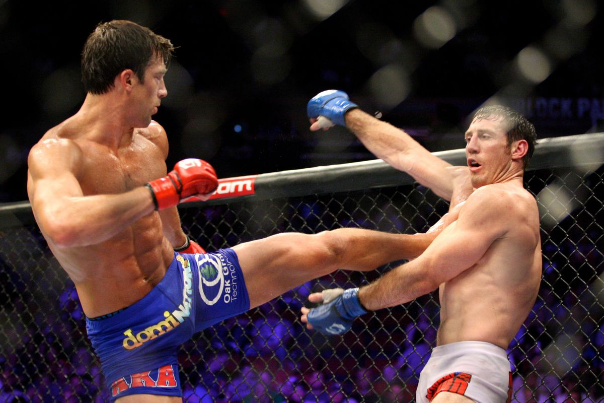 July 14, 2012; Portland, OR, USA; Luke Rockhold (blue shorts) fights Tim Kennedy (white shorts) for the middleweight title at MMA Strikeforce at the Rose Garden Arena. Mandatory Credit: Scott Olmos-US PRESSWIRE