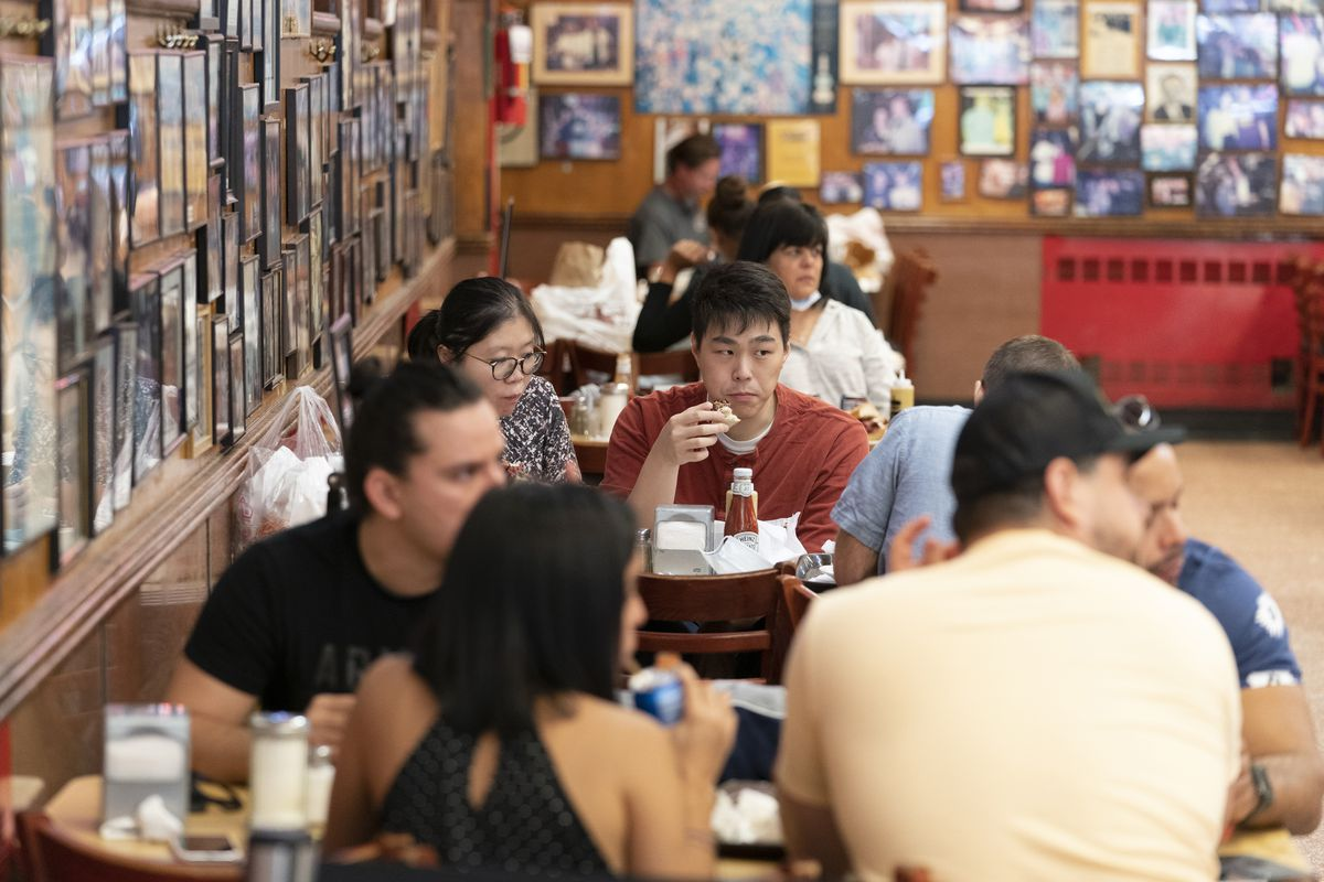 In this Sept. 30, 2020 file photo, customers have lunch at Katz's Delicatessen in New York. New York Mayor Bill de Blasio said Thursday, Nov. 19, 2020, that indoor restaurant service will likely shut down within a week or two to curb the spread of the coronavirus.