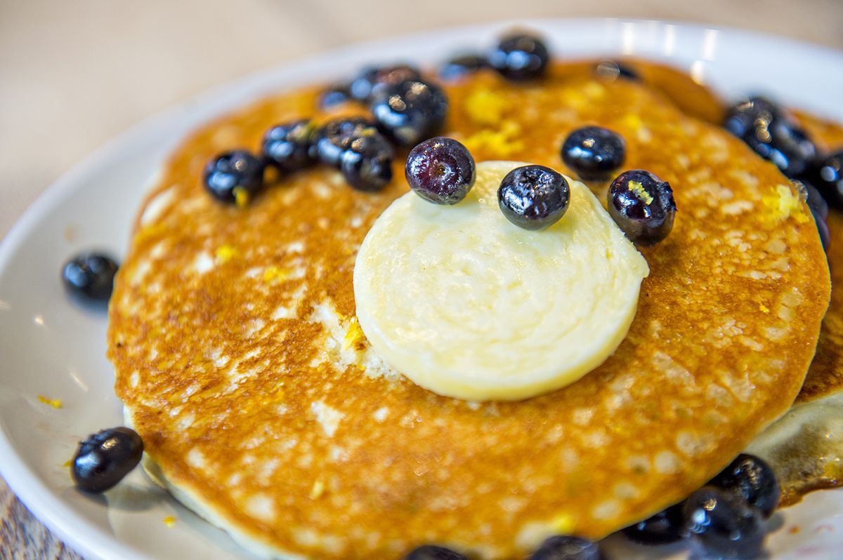 Lemon-ricotta pancakes topped with blueberries and salted cultured butter at Ivy on 7th.