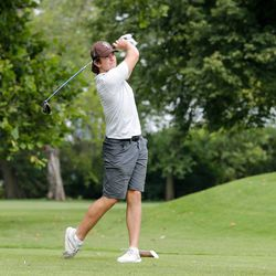 Mount Carmel's Christopher Whelton looks on after teeing off during practice at Jackson Park Golf Course.