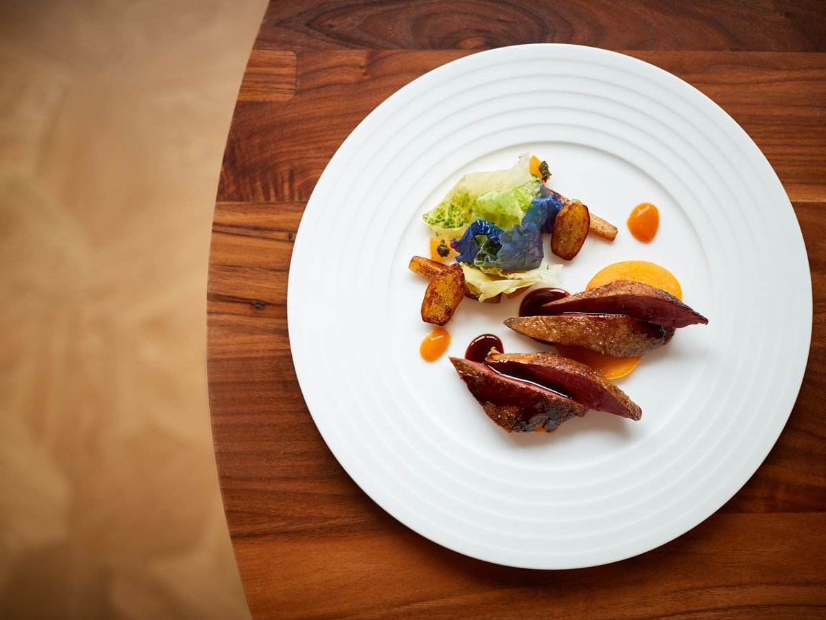 Roast pigeon, persimmon, and chevril root at Trivet, one of the best new restaurants in London