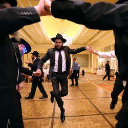 Rabbi Mendy Weitman dances at Chaya Zippel and Rabbi Mendy Cohen's traditional Chabad Lubavitch Jewish wedding at the Grand America Hotel in Salt Lake City on Monday, Sept. 12, 2016.