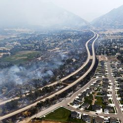 Damage along I-84 can be seen due to a wildfire burning at the mouth of Weber Canyon on Tuesday, Sept. 5, 2017.