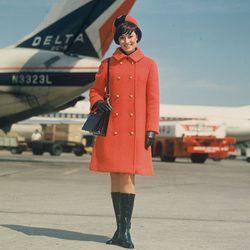 """The 60s winter uniform. Photo via <a href-""""http://www.deltamuseum.org/explore/history/delta-brand/uniforms/propeller-era-uniforms-1940-1959"""">DeltaMuseum.org.</a>"""