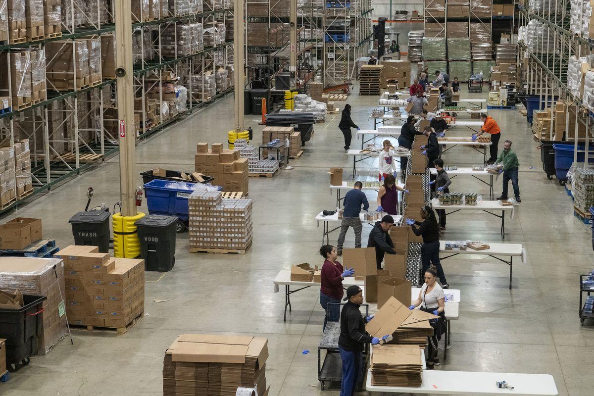 Volunteers help break down and repackage food at the Greater Chicago Food Depository.