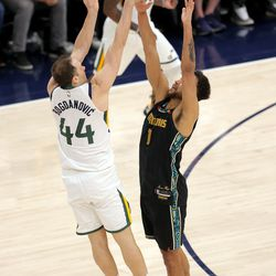 Utah Jazz forward Bojan Bogdanovic (44) throws up a three point shot that would have tied the game over Memphis Grizzlies forward Kyle Anderson (1) as the Utah Jazz fall to the Memphis Grizzlies play in game one of their NBA playoff series at Vivint Arena in Salt Lake City on Sunday, May 23, 2021. Memphis won 112-109.