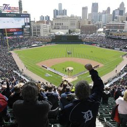 Baseball fans cheer after the national anthem before a baseball game between the Detroit Tigers and the Boston Red Sox in Detroit, Thursday, April 5, 2012.