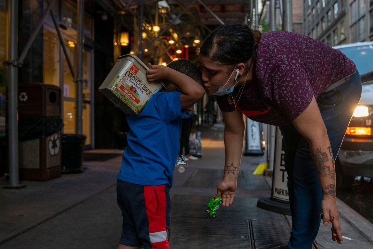 Luz De Jesus, 25, kisses her son, Mackenley Zamilus, 2, ahead of a move to a shelter near the Manhattan Bridge, Sept. 11, 2020.