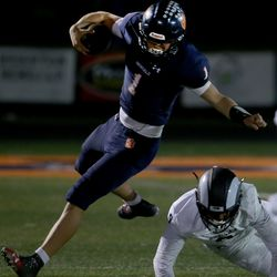 Brighton quarterback Gabe Curtis (1) escapes a tackle by Highland's Blake Yates (9) at Brighton High School in Cottonwood Heights on Wednesday, Oct. 16, 2019.