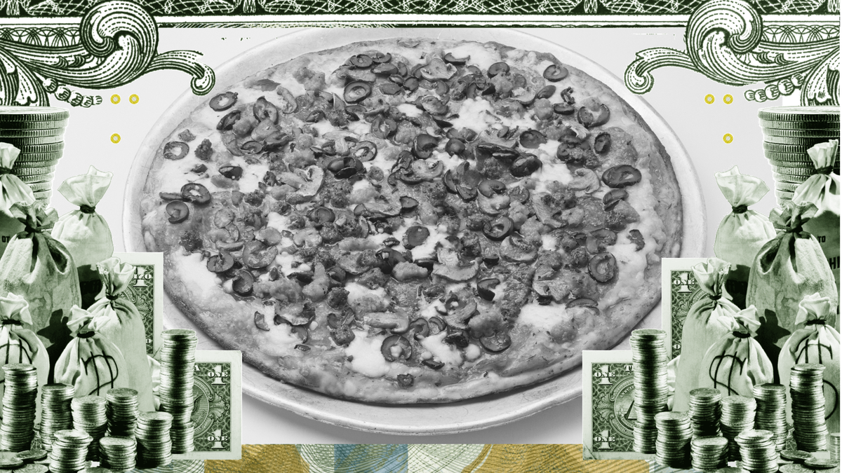 A pizza surrounded by money