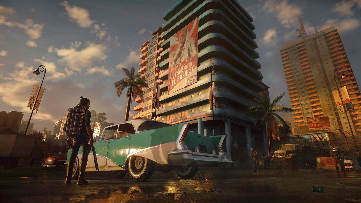 a man standing next to a classic sedan parked outside an apartment building in Far Cry 6