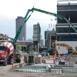 11:30 a.m. Another view of the concrete being poured, along the Waveland side of the triangle lot -
